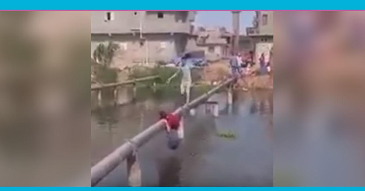شاهد.. تلاميذ بكفر الشيخ يعبرون للمدرسة فوق ماسورة مياه
