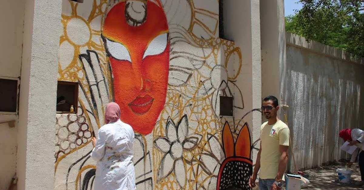 جامعة عين شمس تدشن مبادرة لتجميل أسوار الجامعة «صور»